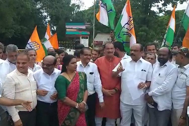 Congress protests against BJP blames state govt for IAS officers resignation