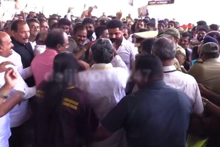 Mangaluru Congress leaders had a jostling match and CM was stuck in the middle