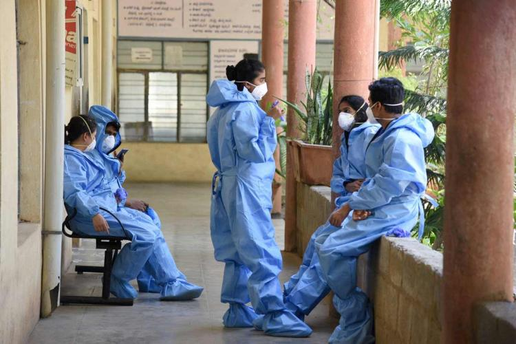 Image of medical staff outside a hospital ward in Bengaluru in PPE