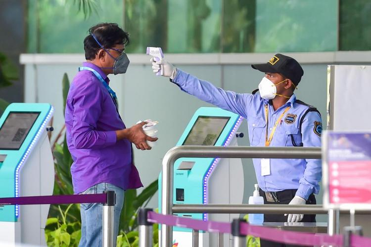 Security guard checking temperature