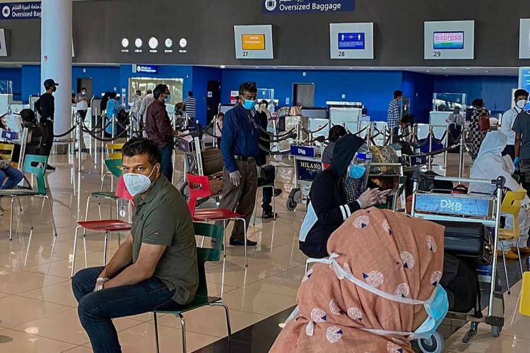 Passengers waiting at an airport terminal in Dubai