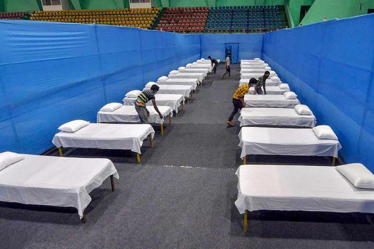 Beds being arranged for patients amid the coronavirus pandemic in India