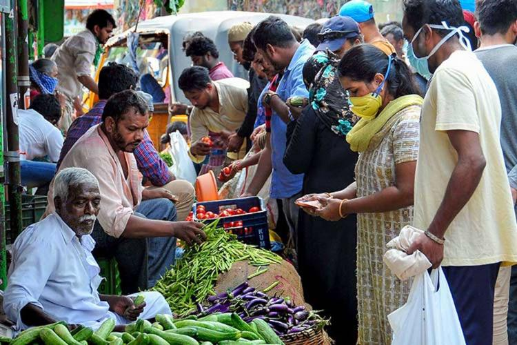people buying vegetables at a market in hyderabad