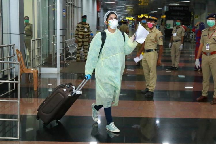 A woman NRI at the Kozhikode airport in Kerala