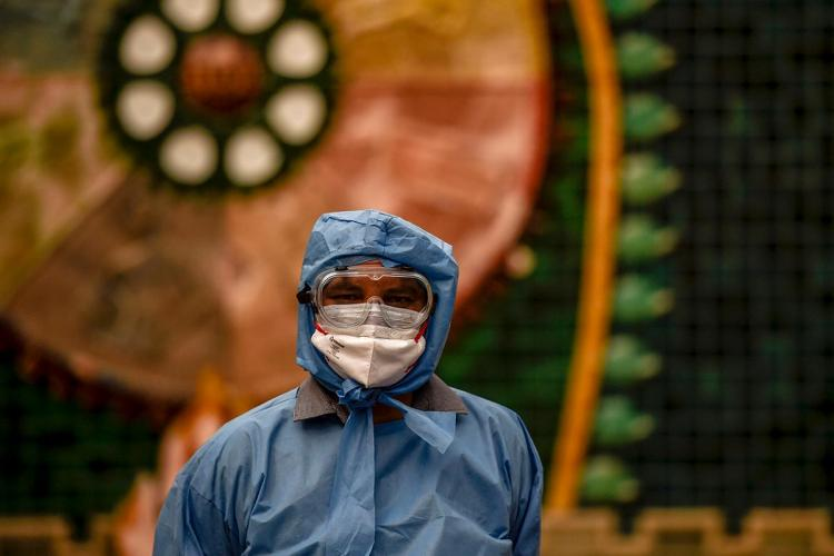 A frontline worker during the coronavirus pandemic seen in a PPE kit