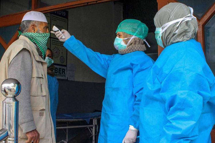 A man undergoing thermal screening in Srinagar.