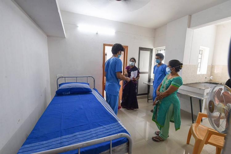 Doctors along with two others at a Chennai hospital talking to each other