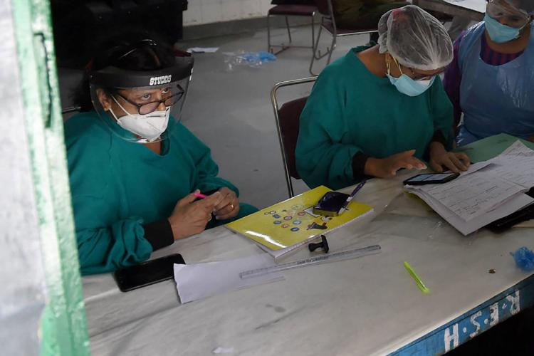 Two health workers at a testing centre