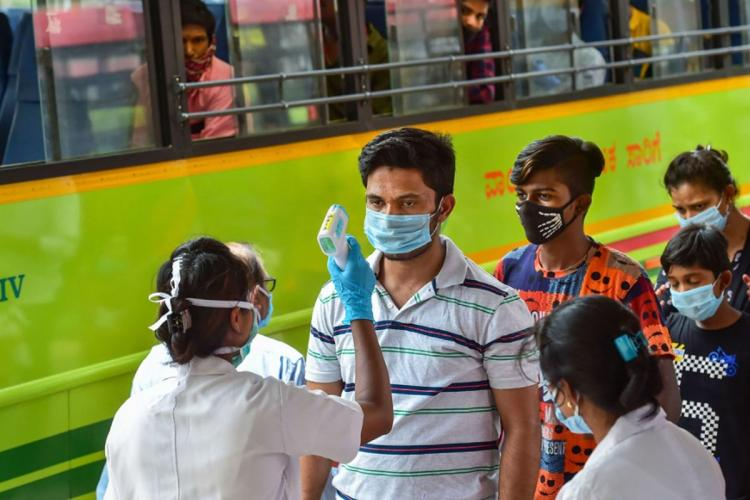 Testing for coronavirus being done at a Bengaluru bus stop