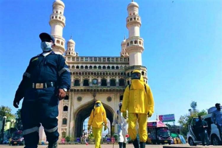 Guards of disaster management step in to disinfect the Charminar area in Hyderabad