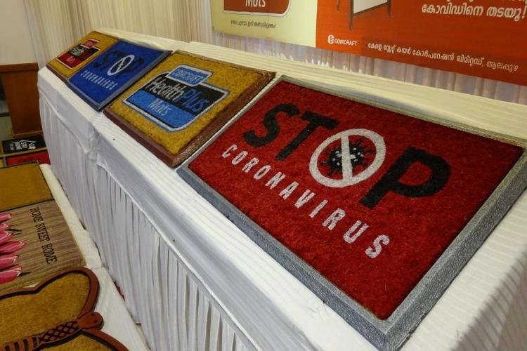 Anti Covid Mats in various colours and designs displayed