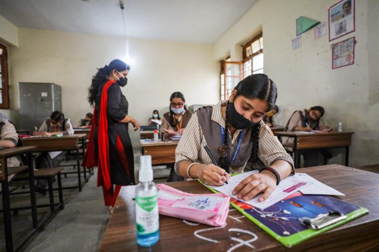 Students wearing face masks appearing for class 10 board exams amid spike in coronavirus cases in Jammu