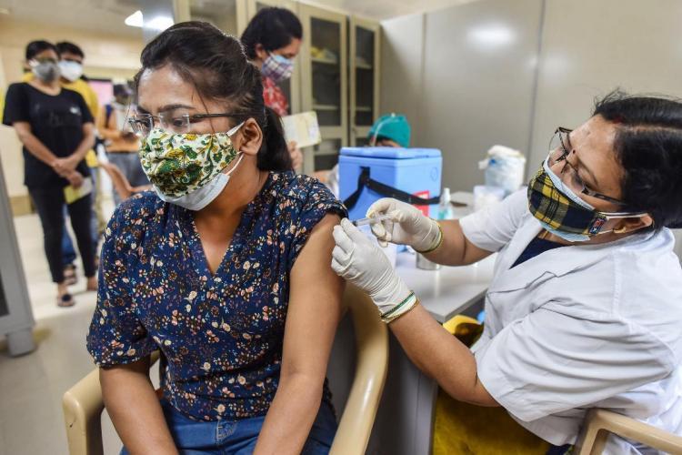 A woman getting COVID-19 vaccine