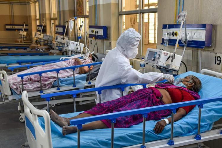 A health worker wearing PPE attends to Covid-19 patients at a ICU COVID Ward with Oxygen and Ventilator facilities in Hyderabad