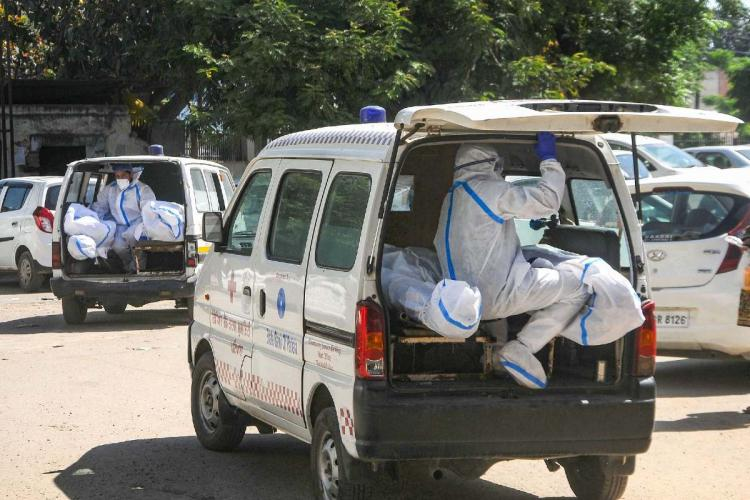 Ambulances transporting bodies of COVID-19 victims in Patiala