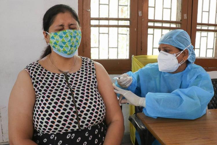 Person getting COVID-19 vaccine jab