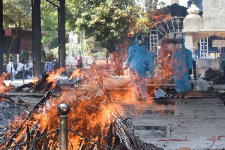 Cremation of COVID-19 victims at Nigambodh Ghat cremation ground as coronavirus cases surge in New Delhi Sunday May 9