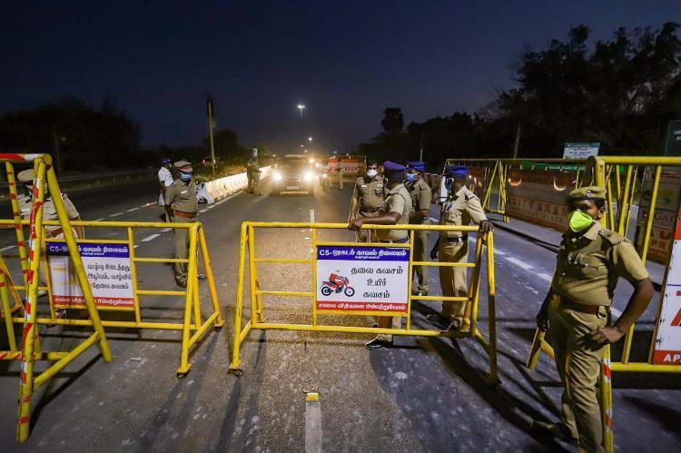 Police patrolling a lane during night curfew in Pudducherry