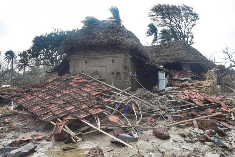 Debris of a damaged house in a village in East Midnapore district, West Bengal, in the aftermath of Cyclone Yaas