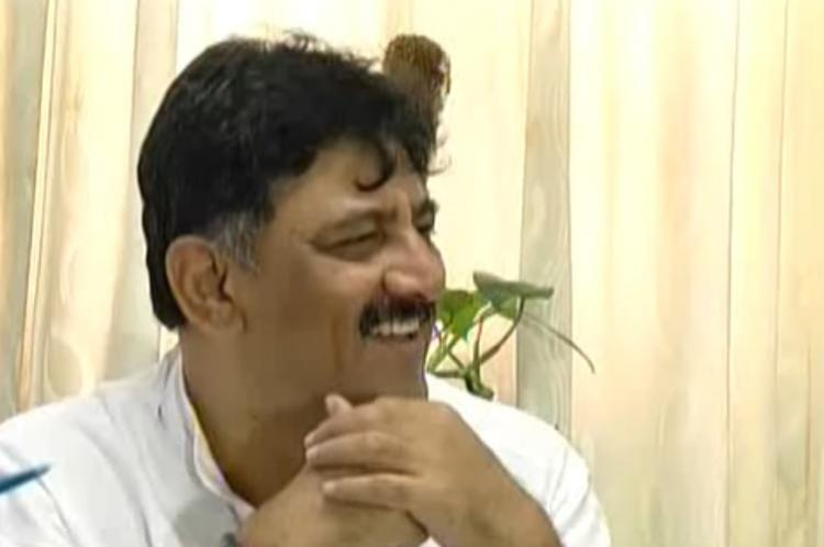 Ktaka Min DK Shivakumar booked by police for not removing illegal ad banner