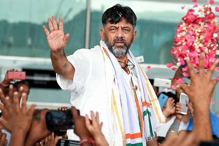 DK Shivakumar waves to supporters