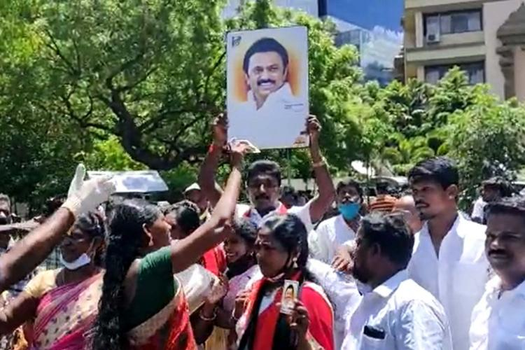 DMK cadre at Anna Arivalayam holding celebrations based on the partys early leads
