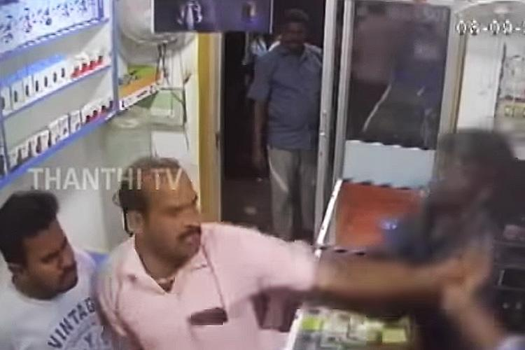 Image result for DMK members attacked mobile repair shop owners