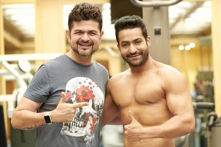 Ace photographer Dabboo Ratnani poses with Jr NTR Dabboo is seen in a grey t-shirt while Jr NTR is shirtless