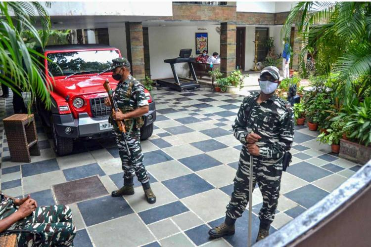 Security personnel stand guard at the residence of the owner of Dainik Bhaskar Group Sudhir Agarwal after Income Tax department raided his premises in Bhopal Thursday July 22 2021