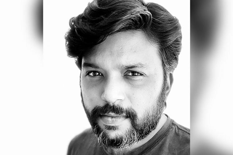 A black and white picture of Pultizer Prize-winning photojournalist Danish Siddiqui