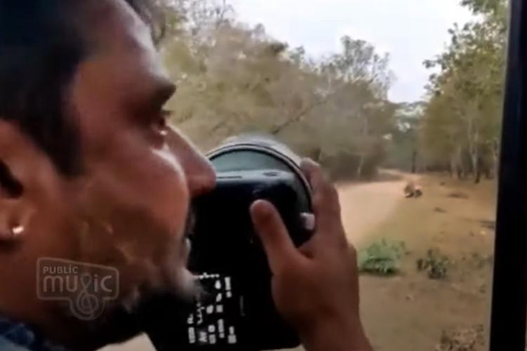Screengrab of the viral video in which Darshan can be seen clicking the tiger