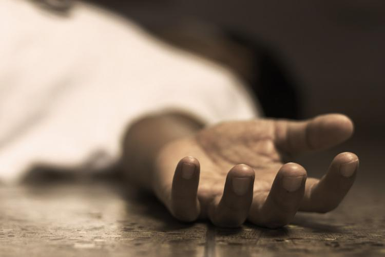 A man is lying down wearing a white shirt and his hand is stretched out - only the hand is clear rest is blurred