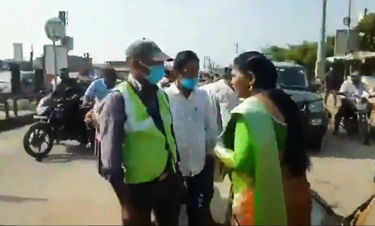 Screenshot of the video in which Revathi is seen arguing with the toll booth employee on road while onlookers are watching her