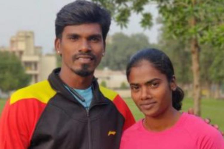 S Dhanalakshmi looking into the camera standing beside her coach