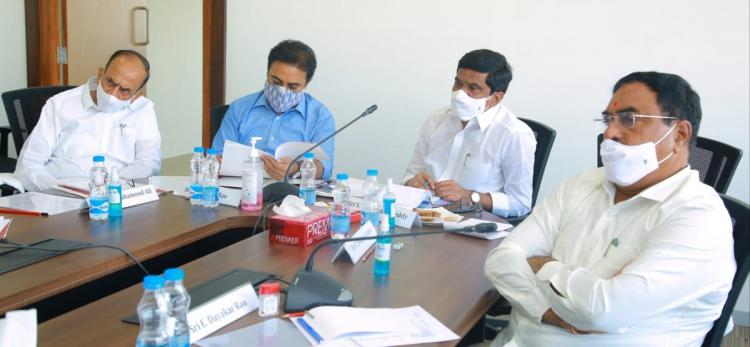 Subcommittee members discussing about issues by wearing masks in a mike