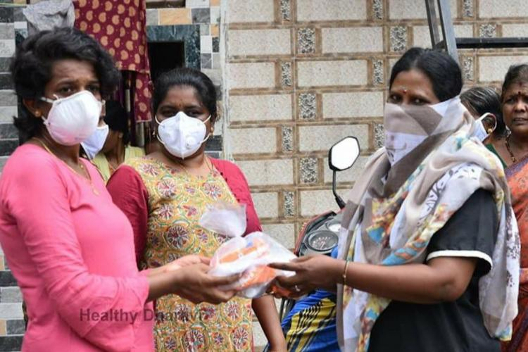 women wearing face masks at a relief camp and a support group in dharavi mumbai