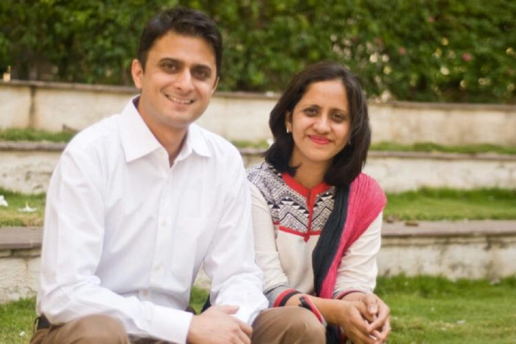 Dhimanth Parekh and Anuradha Kedia posing outdoors smiling at the camera