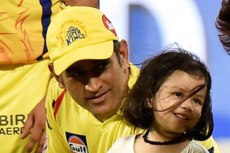 MS Dhoni in is CSK uniform and his daughter, Ziva