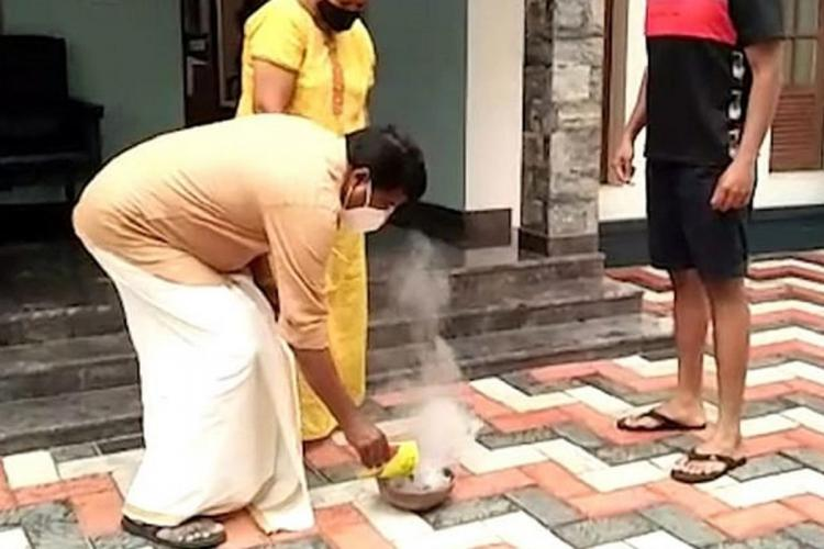 A family taking part in Alappuzha municpality fumigation drive