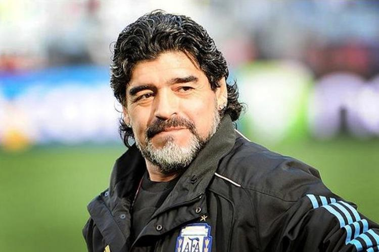 Diego Maradona with a beard and mustache and a black sweatshirt
