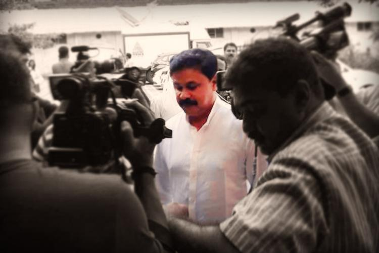 Dileep appearing at trial court in Kochi He is surrounded by media persons
