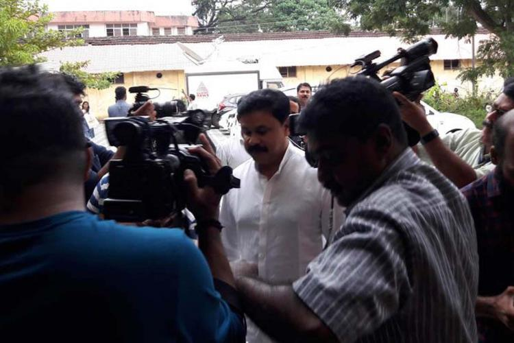 Dileep coming to court in Kochi for the trial Media persons around him