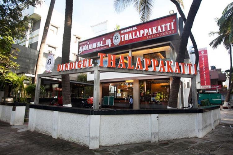 Dindigul Thalappakatti restaurant building in Benglauru at dusk