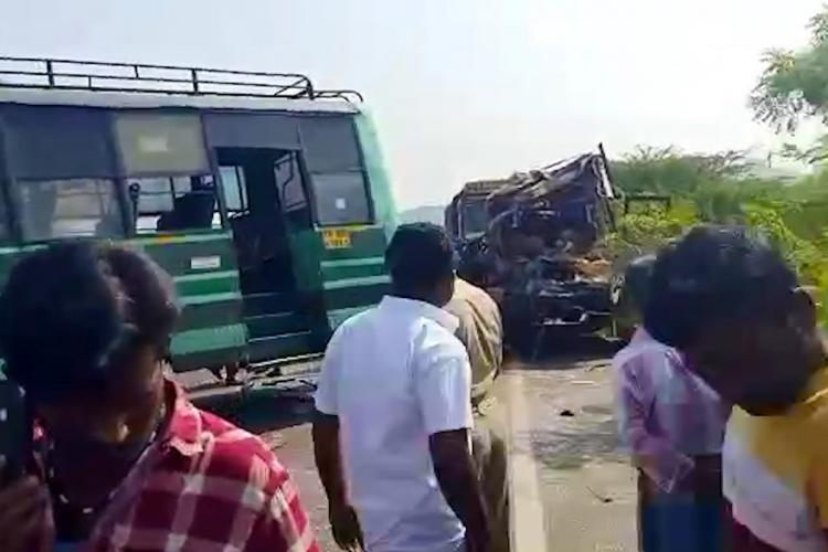 Mangled remains of the van and a TNSTC bus in Dindigul after both collided head-on with each other