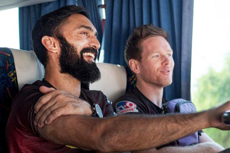 Dinesh Karthik and Eoin Morgan travelling in a bus
