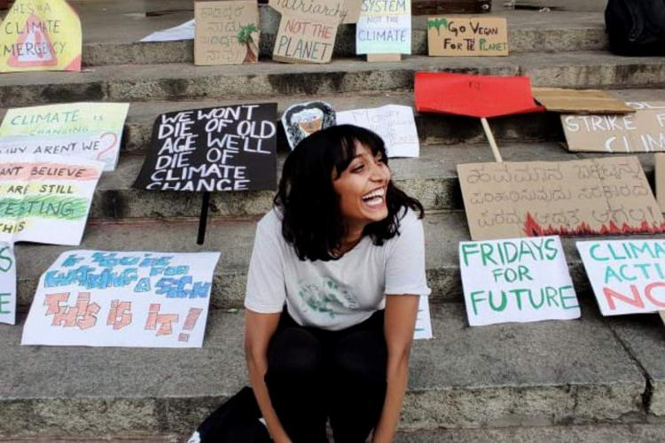 22-year-old Bengaluru climate activist Disha Ravi surrounded by placards with various slogans