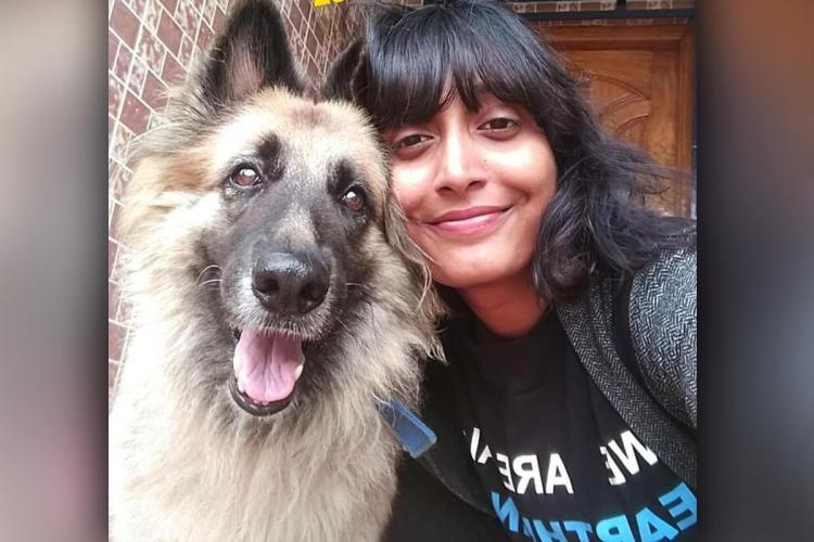 Bengaluru climate activist Disha Ravi posing with her dog