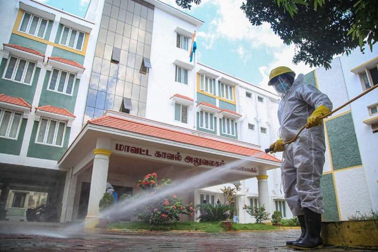 A sanitary worker undertakes disinfection process