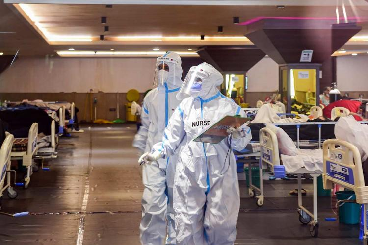 Medical personnel in PPE suits inside a COVID-19 ward