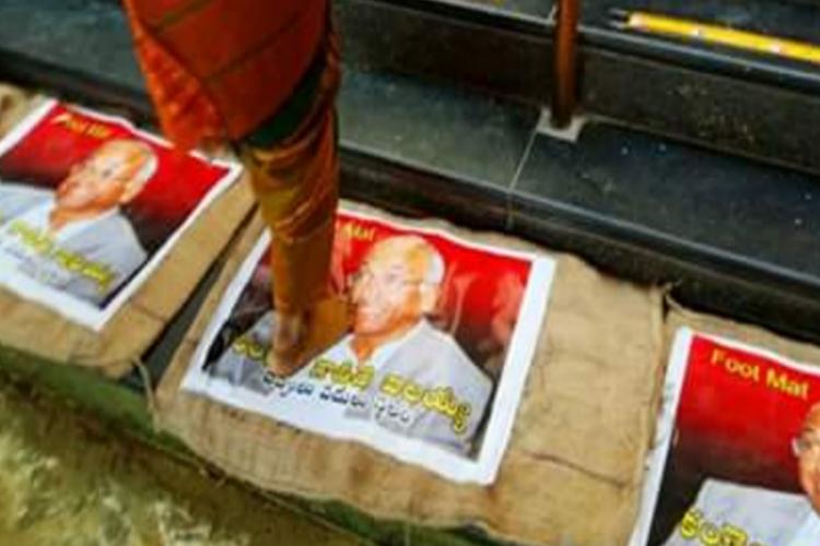 Arya Vaisyas protest with Kancha Ilaiahs face on door mats Dalit activists condemn